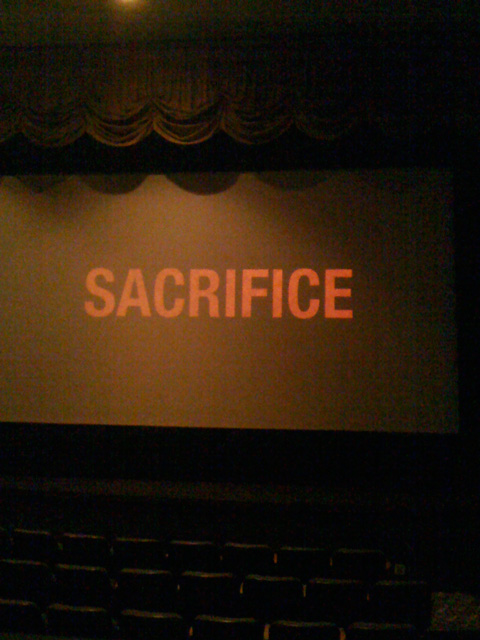 The word sacrifice on movie screen
